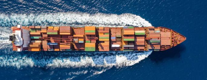 freight ship gliding through the ocean